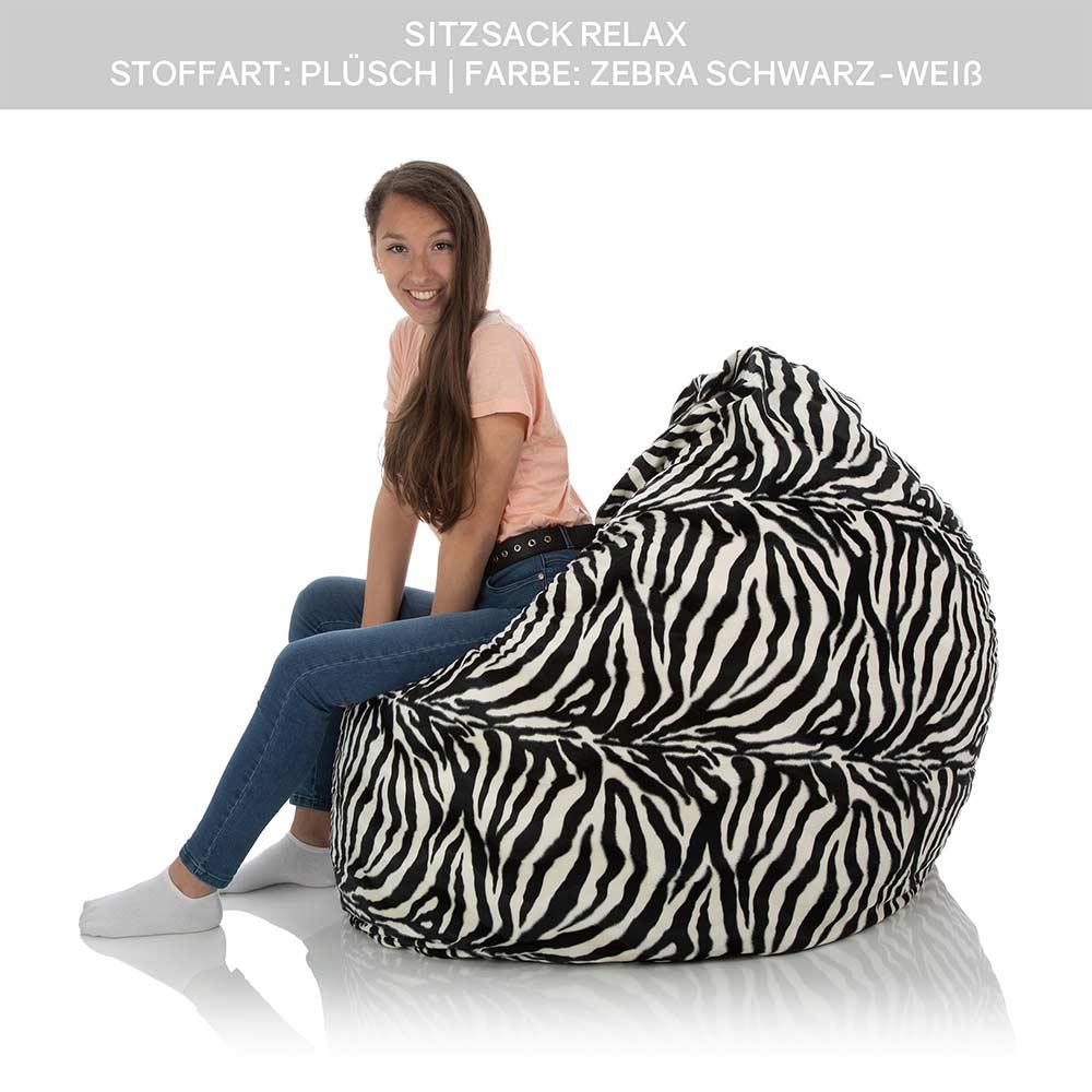 Junge Dame sitzt im XXL Lounge Sitzsack Relax mit Plüsch Bezug Schwarz Weiß