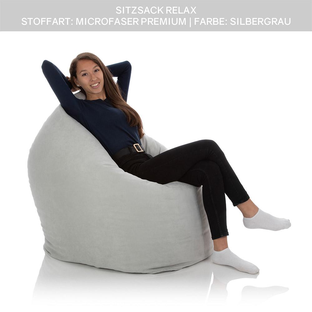 Junges Mädchen sitzt im XXL Sitzsack Sofa Relax grau anthrazit