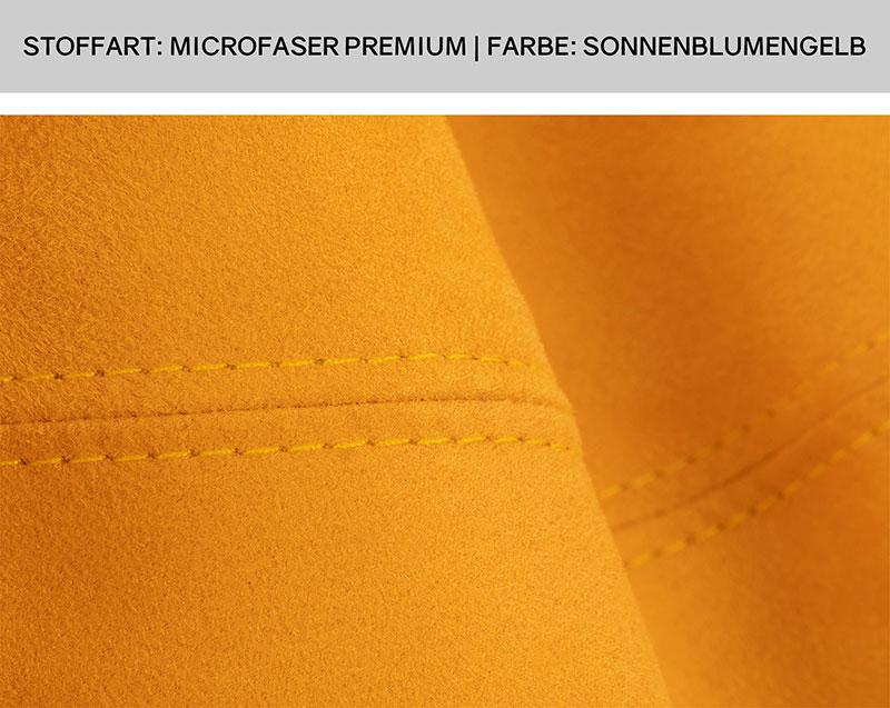 Nahaufnahme einer parallel verlaufenden Sitzsack Doppelsteppnaht auf gelbem Microfaser Stoff